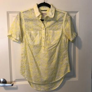 Yellow embroidered blouse.